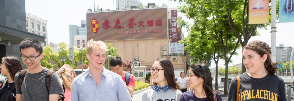 Group of students walking city streets in a foreign country